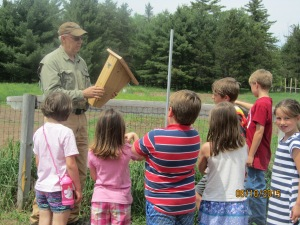 Metro Maznio, board member and nature enthusiast, teaches children about bluebirds
